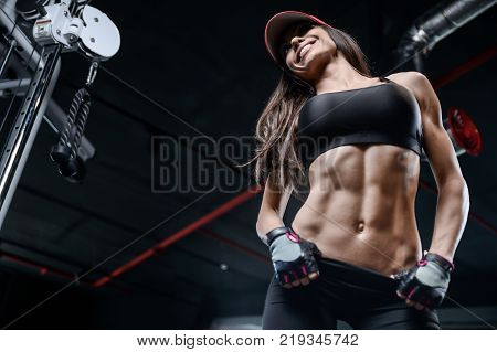 poster of Sexy Athletic Young Girl Training Arms In Gym