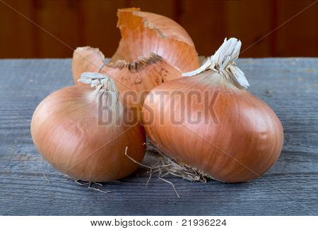 Onions And Peel On A Table