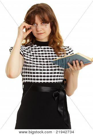 Young Beautiful Woman In Glasses With A Book
