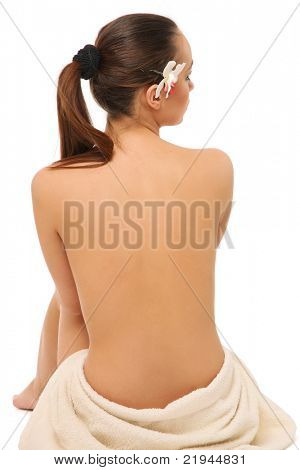 A beautiful female back isolated on white