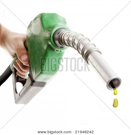 Male hand holding gas pump isolated on white with one last drop of fossil fuel