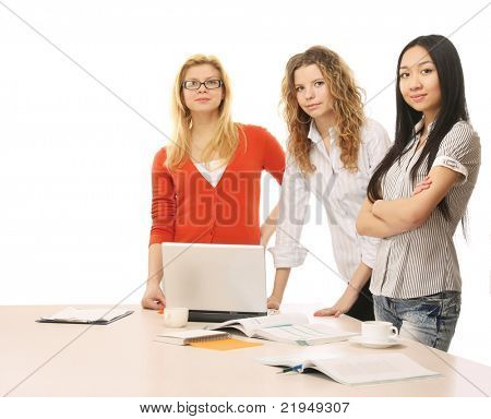 A group of working women is standing near the table - on white background