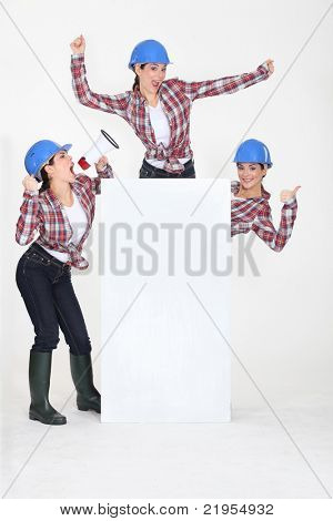 Female construction worker with a board left blank for your message