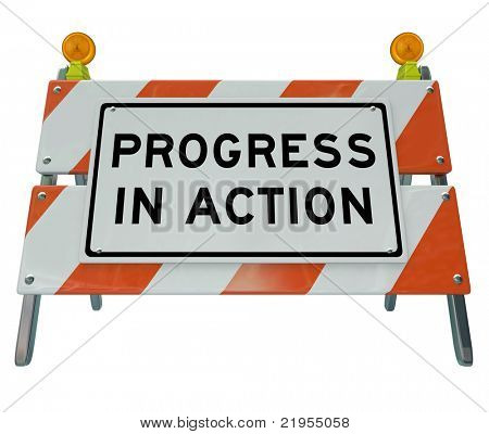 A road barrier reading Progress in Action signifies that work is being done on a project to lead to change and improvement, and that the inconvenience is temporary while we wait for better conditions