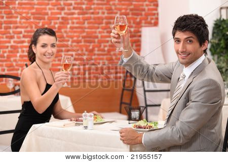Couple drinking wine in restaurant