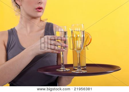 Casual waitress with a tray of drinks
