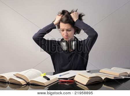 Stressed student revising for an exam