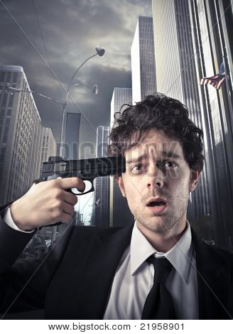 Businessman with a gun pointed at his temple