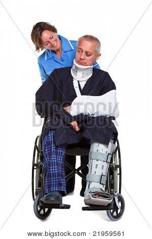 Photo of an injured man in a wheelchair with a female nurse pushing him, isolated on a white background.