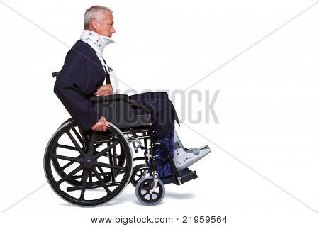 Photo of an injured man pushing himself along in his wheelchair, isolated on a white background.