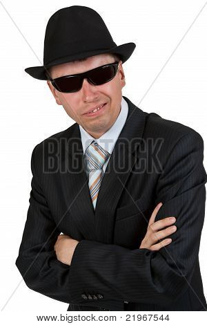 Businessman In Dark Glasses And A Hat