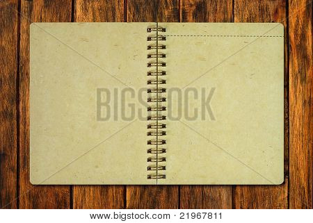 Brown Recycle Paper Notebook On Wood