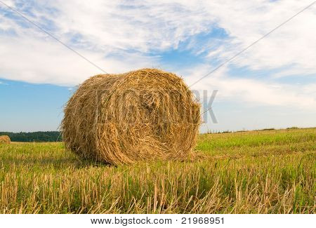 Beautiful Stubble Field With Hay Bales By Summer.