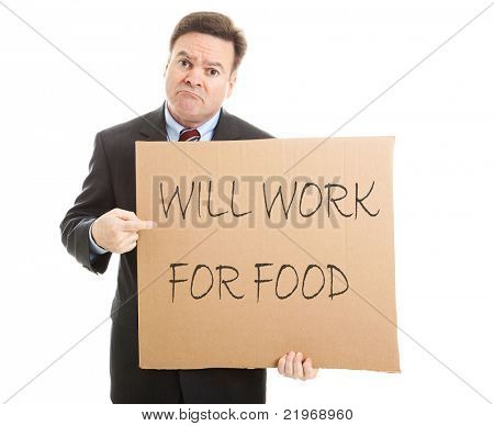 "Desperate, unemployed businessman holding up a message on a cardboard box that says ""Will Work For Food""."