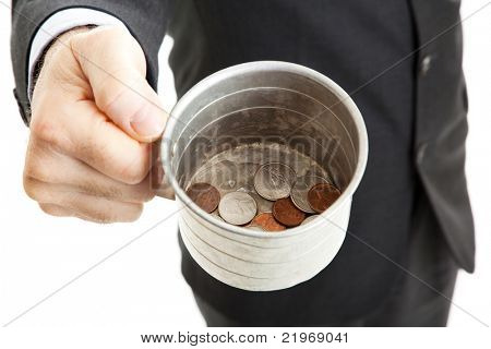 Closeup of a businessman with a tin cup, begging for change.  White background.