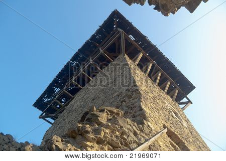 Ruins Of Old Castle Tower Against Blue Sky