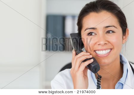 Good Looking Female Doctor On The Phone And Posing