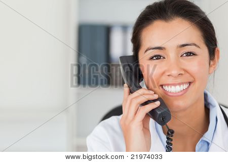 Gorgeous Female Doctor On The Phone And Posing