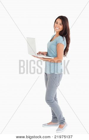 Attractive Woman Relaxing With Her Laptop