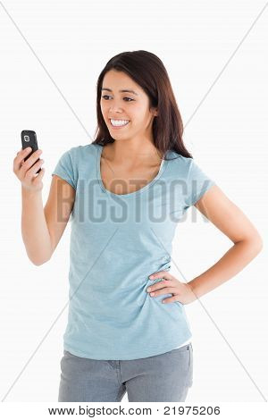 Attractive Woman Looking At Her Mobile Phone