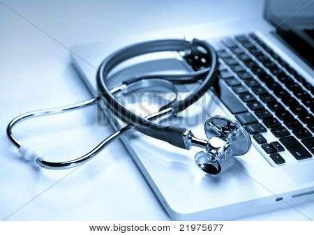 Stethoscope on a laptop computer