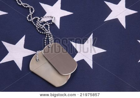 Military Dog tags on star field of american flag