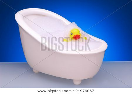 Yellow Rubber Duck in Footed Bathtub with Bubbles
