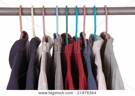 Assorted Golf Shirts on Hangers isolated over white