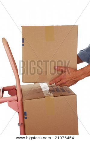 Man Stacking a Moving Box on Hand Truck isolated on white