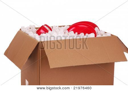 Moving Box With Red Plates and Packing Material isolated over white