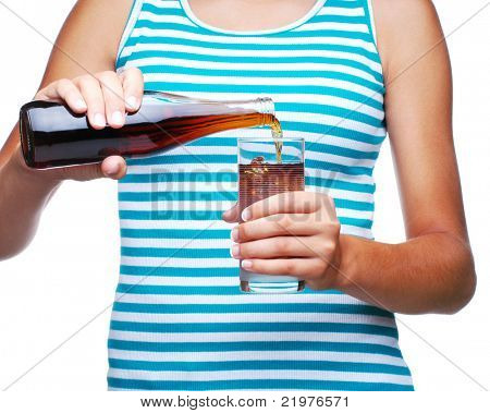 Girl Pouring a Bottle of Soda into a Glass isolated over white