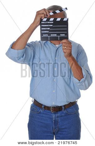 Man holding movie clapboard in front of his face isolated over white