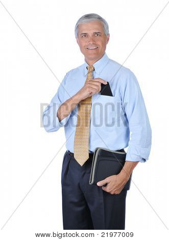 Middle aged Smiling Businessman Putting PDA in Shirt Pocket isolated on white