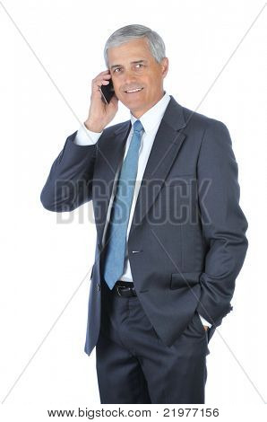 Smiling Middle Aged Businessman with one hand in pocket talking on cellphone isolated on white