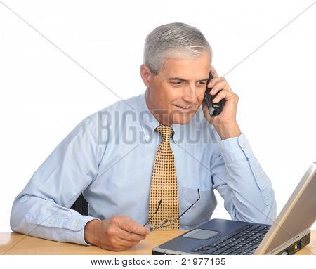 Middle Aged Businessman with laptop and phone