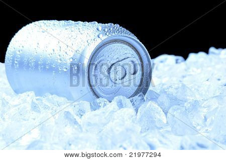 Aluminum Drink Can with water droplets laying in a bed of ice - black background and cool tones