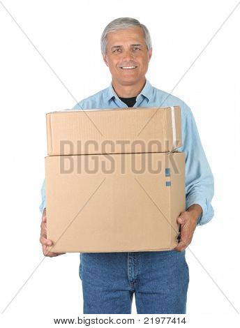 Smiling Middle Aged Deliveryman Carrying Two Cardboard Boxes isolated on white