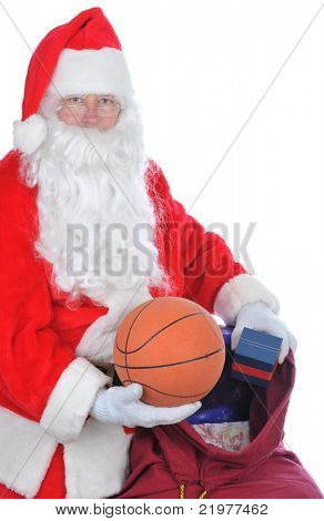 Santa Claus Holding Basketball and his Bag of Toys isolated on white