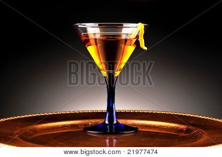 Whiskey Drink and Lemon Twist with light to dark spot lit background. Horizontal Composition