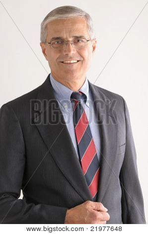 Portrait of a Middle Aged Businessman with Glasses over light gray background