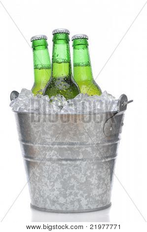 Three Green Beer Bottles in Ice Bucket with Condensation isolated on white vertical composition with reflection