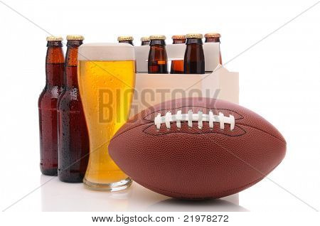 Six pack of beer and frothy glass with an American Football in front. Horizontal format isolated on white with reflection.