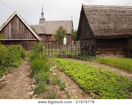 Two very old countryside houses with a garden