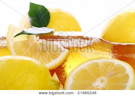 Bottle Of Cold Beer With Fresh Lemons
