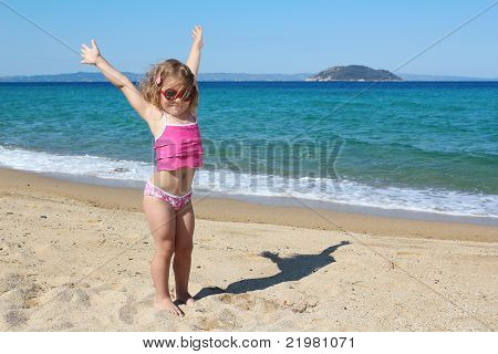 happy young girl with hands up