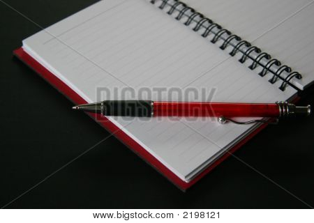Notebook With Red Pen On Black Background 48