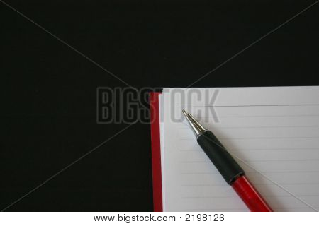 Notebook With Red Pen On Black Background 59