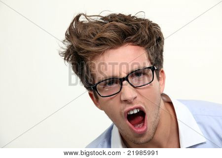 Angry young man in glasses