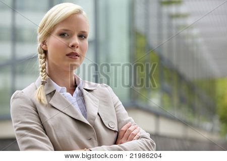 Blonde executive standing outside