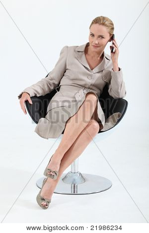 Smart executive woman using a telephone
